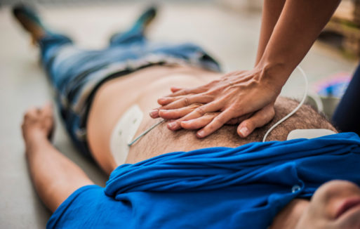 A person performing CPR blurs the line between life and death