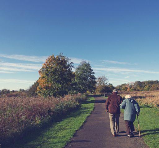 Elderly couple walking symbolizing aging.
