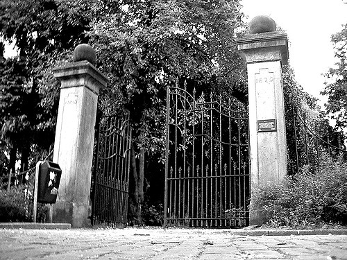 Opened cemetery gate symbolizing that people have entered the cemetary