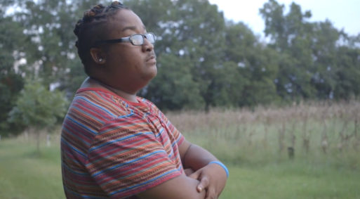 "Kendrick Evans standing in a field looking outwards thinking about his illness as seen in ""My Last Days"""