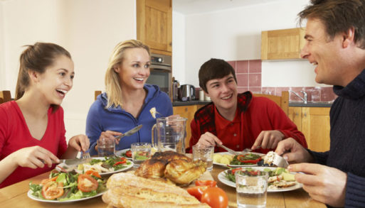 Family avoiding obesity by eating a healthy meal