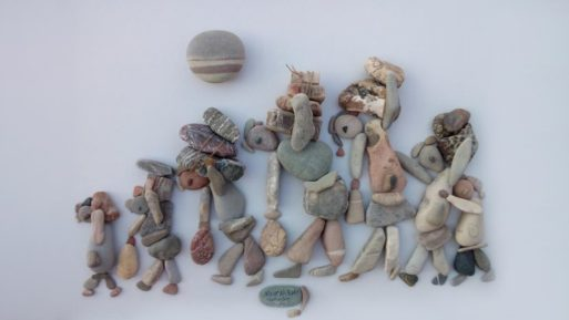 Pebble art depicting fleeing refugees by Nizar Ali Badr