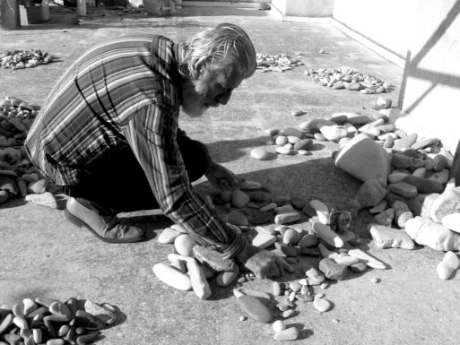 Nizar Ali Badr working with stones at his home in Syria
