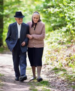 Senior man and woman walking together. Even couples can be victims of elder abuse.