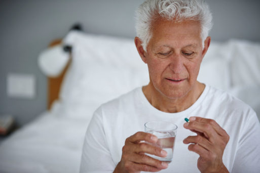 Man taking a pill to demonstrate placebo effect