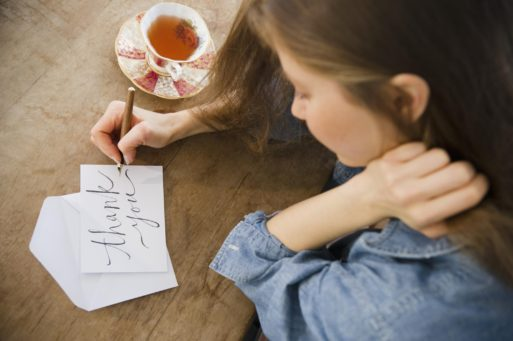 Woman writing thank you notes