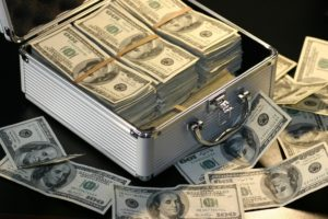 Briefcase overflowing with $100 bills