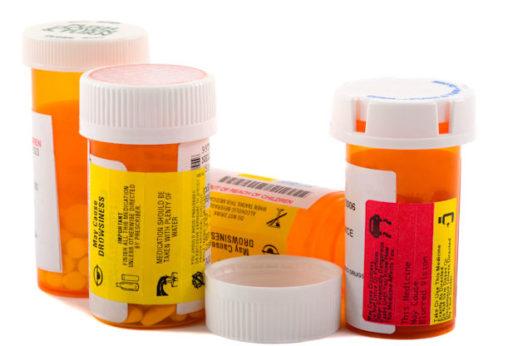 Pill bottles symbolizing drug expiration dates