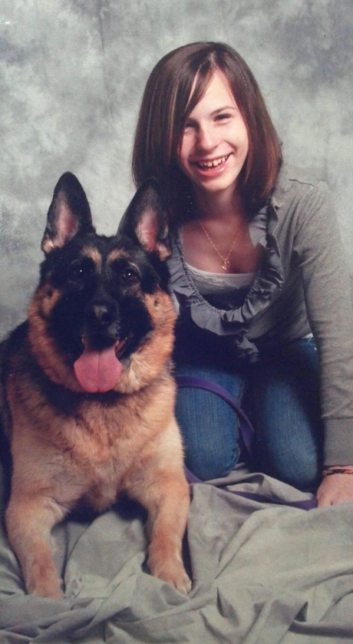 A photo of Justina Pelletier, who was diagnosed with mitochondrial disease, and her dog, a German Shepherd