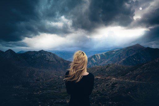 Woman looking out over a gathering storm