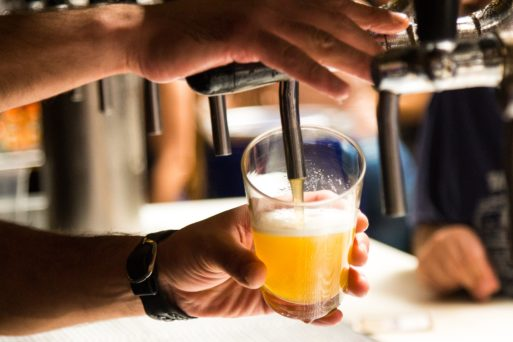 Draft beer being poured at a bar