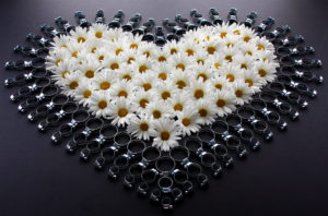 A heart made of hose clamps ad daisies from Monday Hearts for Madalene