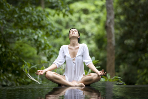 Woman breathing and meditating