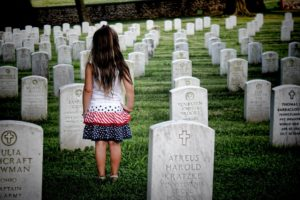 "A girl stands at her parent's grave, like the young girl in ""I'm Here"""