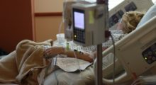 Woman in hospital bed with short life expectancy