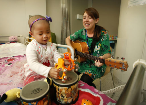 Music therapist works with cancer patient