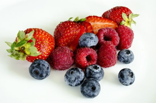 Bunch of blueberries, raspberries and strawberries symbolizing good nutrition