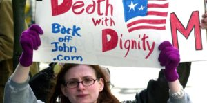 Woman protesting repeal of D.C. Death with Dignity Act
