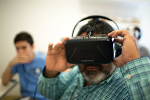 A man wears a virtual reality bucket list headset