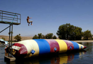 Grieving children enjoywater play at Kids Camp