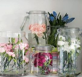 Flowers inside mason jars to hang on a memorial tree