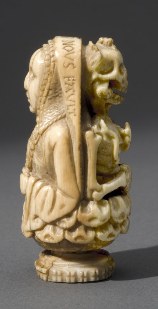 "A prayer bead on exhibit in ""The Ivory Mirror"" shows a human on one side and a skeleton on the other"