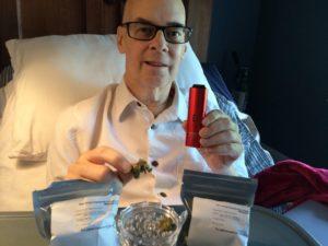 Mark Mooney holding medical cannabis
