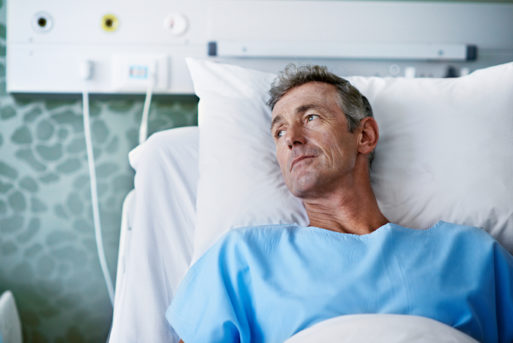 Man alone in a hospital bed