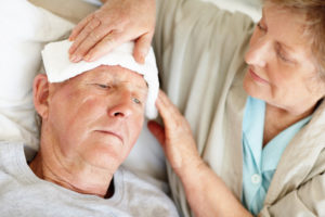 A hospice worker provides comfort measures for patient in hospice care