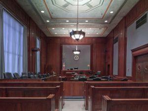 Empty courtroom symbolizing a criminal trial