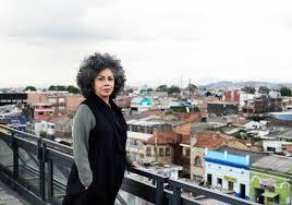 Doris Salcedo stands on a balcony in Colombia