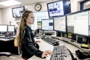 Woman working a police department dispatch system