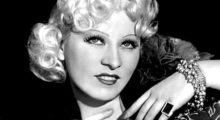 A portrait of Mae West smiling.
