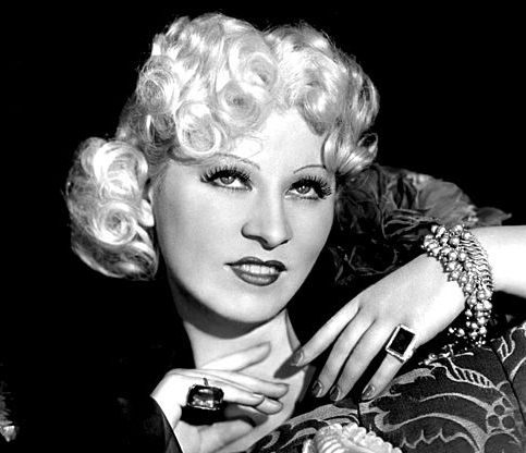A portrait of Mae West smiling