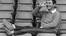 Funny Portrait of Brian Clough in stadium seats