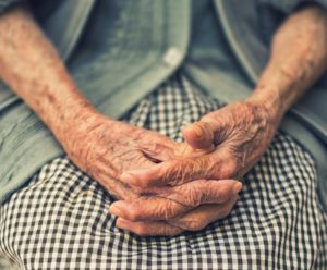 Close up of elderly woman's hands who desires death with dignity