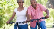 Elderly couple riding bicycles symbolizing exercise.