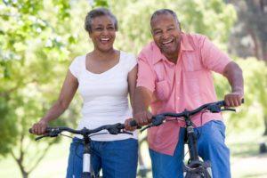 Elderly couple riding bicycles symbolizing exercise