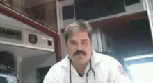 A photo of Dennis Kowalski sitting in an emergency vehicle