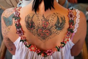 A cremation tattoo with angels and a heart